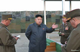 FILE - North Korean leader Kim Jong Un (C) speaks with soldiers from the communist nation, August 2014.
