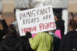 A supporter holds up a placard during a rally for Jeanette Vizguerra, a Mexican woman seeking to avoid deportation from the United States, outside the Immigration and Customs Enforcement office in Centennial, Colo., Feb. 15, 2017. U.S. immigration au