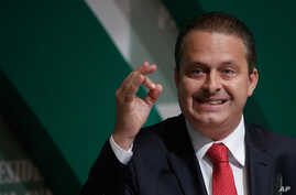 In this Aug. 6, 2014 photo, Brazilian Socialist Party (PSB) presidential candidate Eduardo Campos campaigns in Brasilia, Brazil.