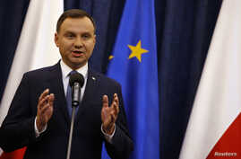 Poland's President Andrzej Duda speaks at the Presidential Palace in Warsaw, Poland, on Dec. 28, 2015. Duda signed into law an amendment to how its constitutional court makes rulings.