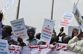 Demonstrators at a peace rally in Juba on Monday, March 10, 2014, carried anti-UN signs.