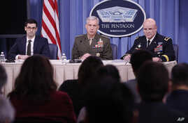 Marine Gen. Thomas D. Waldhauser, commander, U.S. Africa Command, center, with Assistant Secretary of Defense for International Security Affairs Robert S. Karem, left, and Army Maj. Gen. Roger L. Cloutier, right, chief of staff, U.S. Africa Command,