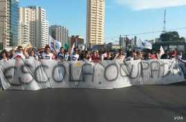 Students marching in the Brazilian state of Mato Grosso demand that a parliamentary commission of inquiry investigate alleged misappropriation and embezzlement of funds that had been earmarked for various education programs. (Photo – courtesy of Juar