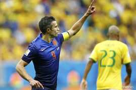 Robin van Persie of the Netherlands celebrates after scoring a goal from a penalty kick during their 2014 World Cup third-place playoff against Brazil, Brasilia national stadium, July 12, 2014.