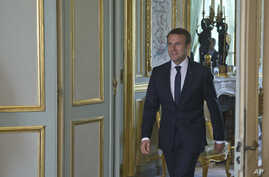 FILE - French President Emmanuel Macron is seen at the Elysee Palace in Paris, France, May 23, 2017. On Monday, Macron will host Russian President Vladimir Putin in what will be their first meeting.