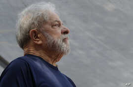 FILE - Former Brazilian President Luiz Inacio Lula da Silva looks on before speaking to supporters outside the Metal Workers Union headquarters in Sao Bernardo do Campo, Brazil, April 7, 2018.