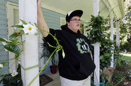 FILE - Gavin Grimm is interviewed at his home in Gloucester, Virginia, Aug. 25, 2015. Grimm is a transgender student whose demand to use the boys' bathrooms has divided the community and prompted a lawsuit.