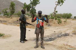 Members of a civilian vigilante group stand guard at the border with Nigeria in Kerawa, Cameroon, March 16, 2016. Kerawa is on the border with Nigeria and is subject to frequent Boko Haram attacks.