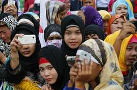 Filipino Muslims join a protest at the Philippine Congress, Feb. 3, 2016, at suburban Quezon city, northeast of Manila, Philippines.