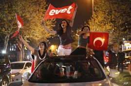 """Supporters of the """"Yes"""" vote, wave flags during celebrations in Istanbul, on Sunday, April 16, 2017."""