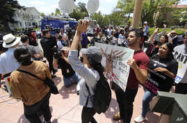 FILE - Supporters of the Deferred Action for Childhood Arrivals Act (DACA) and others demonstrate outside the U.S. District Court 9th Circuit in Pasadena, Calif., May 15, 2018.