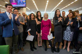 New York Times staff writers, 3rd L - R; Jodi Kantor, Megan Twohey, senior enterprise editor Rebecca Corbett and reporter Cara Buckley celebrate with colleagues in the newsroom after the team they led won the 2018 Pulitzer Prize for Public Service in