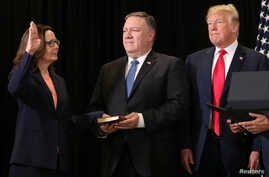 Gina Haspel is sworn in as the new U.S. CIA director as Secretary of State Mike Pompeo holds the bible and President Donald Trump looks on during ceremonies at the headquarters of the Central Intelligence Agency in Langley, Virginia, May 21, 2018.