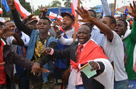 FILE - Congo opposition party supporters demonstrate during a rally against President Joseph Kabila running for president for a fourth term in Kinshasa, Democratic Republic of Congo, Sept. 15, 2015.