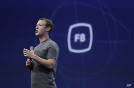 FILE - In this March 25, 2015, file photo, CEO Mark Zuckerberg gestures while delivering the keynote address at the Facebook F8 Developer Conference in San Francisco. Zuckerberg said Tuesday, Sept. 15, Facebook may finally be getting a button that le