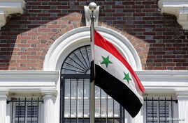 FILE - A flag flies at the Syrian Embassy in Washington.