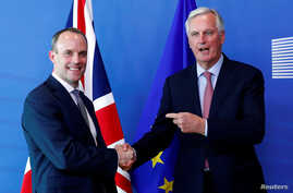 Britain's Secretary of State for Exiting the European Union, Dominic Raab and European Union's chief Brexit negotiator, Michel Barnier, pose ahead of a meeting in Brussels, Belgium, July 19, 2018.