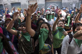 Youths shout slogans against the government of President Jimmy Morales, in Guatemala City, Sept. 11, 2018. Morales had announced that he would not renew the U.N.-backed commission investigating corruption in the country for another two-year mandate, ...