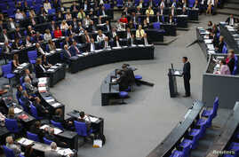 """Cem Oezdemir of the environmental Greens party (Die Gruenen) addresses a session of the Bundestag, lower house of parliament, being held to debate approval of a symbolic resolution that declares the 1915 massacre of Armenians by Ottoman forces a """"gen"""