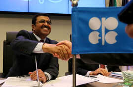 Mohammed Bin Saleh Al-Sada, Minister of Energy and Industry of Qatar and President of the OPEC Conference speak to journalists prior to the start of a meeting of the Organization of the Petroleum Exporting Countries, OPEC, at their headquarters in Vi
