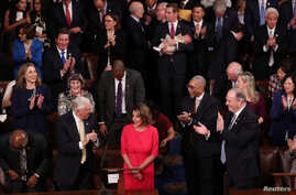 House Democratic leader Nancy Pelosi (D-CA) is applauded by U.S. Rep. Steny Hoyer (D-MD) and other members as she is nominated for House Speaker as the U.S. House of Representatives meets for the start of the 116th Congress on Capitol Hill in Washing
