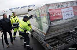 Officials load ballot boxes with votes from expatriates on the constitutional referendum from a truck onto a plane for shipment to Turkey at Tegel airport in Berlin, Germany, April 11, 2017.