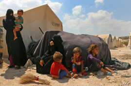 Displaced Syrians are seen at a camp in Kafr Lusin near the Bab al-Hawa border crossing with Turkey in the northern part of Syria's rebel-held Idlib province on September 6, 2018.