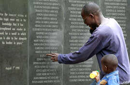 A survivor pays homage at the memorial wall with the names of 248 people killed in the 1998 bombing of the U.S.embassy are seen on the memorial wall in Nairobi. Al Qaeda leader Osama bin Laden was killed in a U.S. helicopter raid on a mansion near th