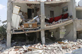 On going fighting in Syria caused damage to the building pictured, in the town of Morek in Hama province, July 21, 2014.