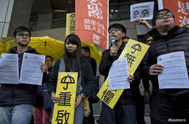 FILE -Hong Kong student leaders (L-R) Oscar Lai, Agnes Chow, Joshua Wong and Derek Lam speak as they arrive at the police headquarters in Hong Kong January 16, 2015.