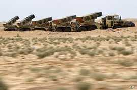Libyan government army rocket launchers are seen in the desert near the west gate of town Ajdabiyah, March 17, 2011
