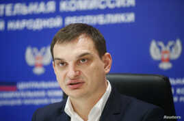 Roman Lyagin, head of the electoral commission of the self-proclaimed Donetsk People's Republic, speaks during a news conference in Donetsk, eastern Ukraine, Oct. 28, 2014.