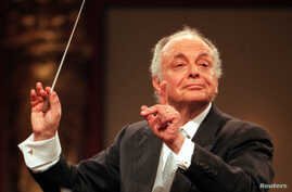 FILE - Maestro Lorin Maazel conducts the Vienna Philharmonic Orchestra during the main rehearsal for the annual New Years Concert Dec. 30, 1998.