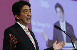 Japan's Prime Minister Shinzo Abe delivers the opening keynote address for the 13th International Institute for Strategic Studies (IISS) Asia Security Summit: The Shangri-La Dialogue, in Singapore May 30, 2014.