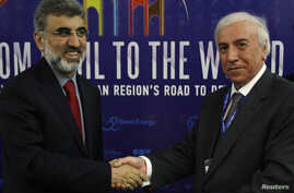 FILE - Kurdistan RaKurdistan Regional Government Natural Resources Minister Ashti Hawrami (R) shakes hands with Turkey's Energy Minister Taner Yildiz during a joint news conference in Arbil, about 350 km (217 miles) north of Baghdad, May 20, 2012.egi