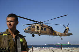 An Israeli air force black hawk helicopter carrying two wounded Israeli soldiers comes in to land at a hospital in the northern city of Haifa, Oct. 7, 2014.