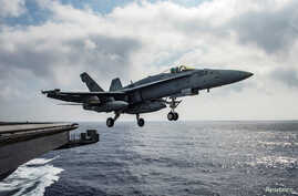FILE - A U.S. Navy F/A-18E Super Hornet launches from the flight deck of the aircraft carrier USS Dwight D. Eisenhower in the Mediterranean Sea, June 28, 2016.