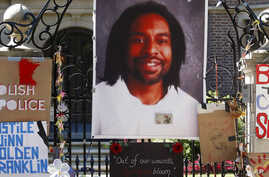 FILE - A memorial including a photo of Philando Castile adorns the gate to the governor's residence, July 25, 2016, where protesters demonstrated in St. Paul, Minn., against the July 6 shooting death of Castile by police officer Jeronimo Yanez. Prose...