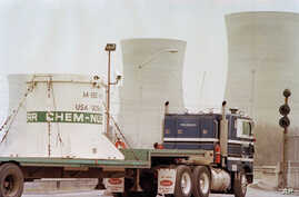 \An empty containment tank enters the Three Mile Island nuclear power plant at Middletown, Penn., March, 1979. (AP Photo/RIG)