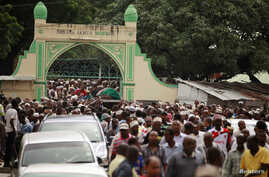 FILE - Muslims faithfuls carry a coffin with the body of Sheikh Mohammed Idris, chairman of the Council of Imams and Preachers of Kenya (CIPK), who was gunned down by assailants, during his funeral at the coastal port town of Mombasa, June 10, 2014.
