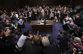Attorney General Jeff Sessions arrives to testify before the Senate Intelligence Committee hearing about his role in the firing of James Comey, his Russian contacts during the campaign and his decision to recuse from an investigation into possible ti