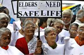 FILE - Elderly women participate in a walk organized to mark the World Elder Abuse Awareness Day in Bangalore, India, June 15, 2011.