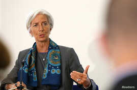 IMF Managing Director Christine Lagarde prepares to host a news conference at the Treasury in London, June 6, 2014.