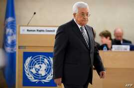 Palestinian President Mahmud Abbas arrives to delivers a speech during the United Nations Human Rights Council on Feb. 27, 2017 in Geneva.