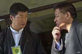 FILE - Prime Minister of the exile Tibetan government, Lobsang Sangay, left, talks to Speaker of the exile Tibetan parliament, Penpa Tsering, in Dharmsala, India.