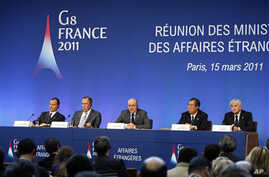 French Foreign Minister Alain Juppe, center, addresses reporters during a joint press conference held at the end of the G8 Foreign Ministers meeting in Paris, March 15, 2011