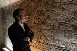 French President Emmanuel Macron visits the temple of Abu Simbel in southern Egypt, Jan. 27, 2019.