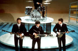 """FILE - In this Feb. 9, 1964 file photo, The Beatles perform on the CBS """"Ed Sullivan Show"""" in New York."""