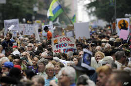 People fill 58th Street between 8th and 9th Avenue before a climate changes protest march in New York, Sept. 21, 2014.