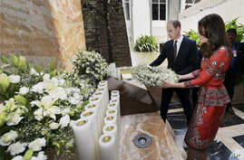 The Duke and Duchess of Cambridge, Prince William, and his wife, Kate, lay a wreath on the martyrs memorial at the Taj Mahal Palace Hotel in Mumbai, India, April 10, 2016.